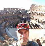 A panoramic selfie of Chris from the upper causway inside the ancient stone Colosseum.